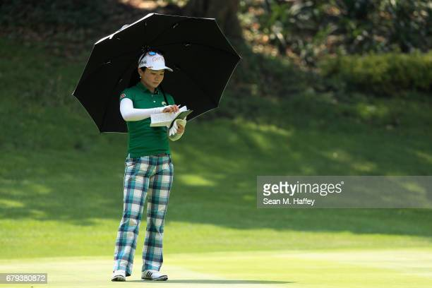 Ayako Uehara of Japan marks her score on the twelth green during the second round of the Citibanamex Lorena Ochoa Match Play Presented by Aeromexico...