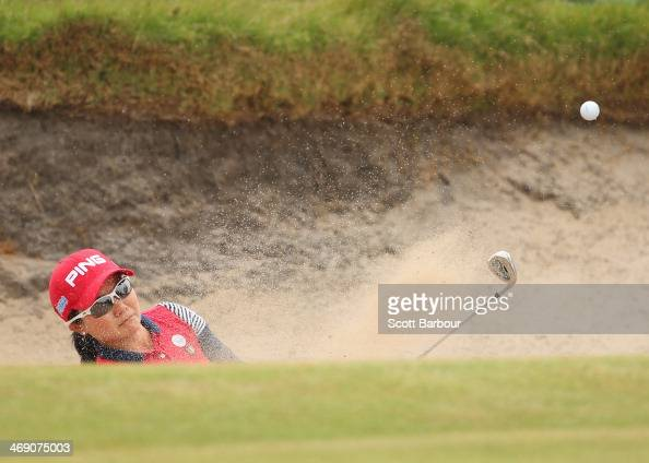 Ayako Uehara of Japan plays out of a bunker during day one of the ISPS Handa Women's Australian Open at The Victoria Golf Club on February 13 2014 in...