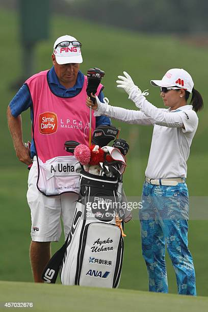 Ayako Uehara of Japan prepares to play on the 8th hole during day three of the Sime Darby LPGA at Kuala Lumpur Golf Country Club on October 11 2014...