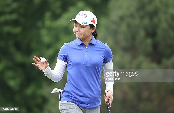Ayako Uehara of Japan waves to the fans after making her putt on the 4th hole during the first round of the Meijer LPGA Classic on June 16 2016 at...
