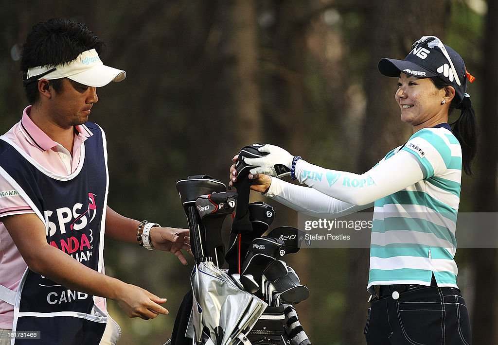 Ayako Uehara of Japan with her caddy during day two of the ISPS Handa Australian Open at Royal Canberra Golf Club on February 15, 2013 in Canberra, Australia.