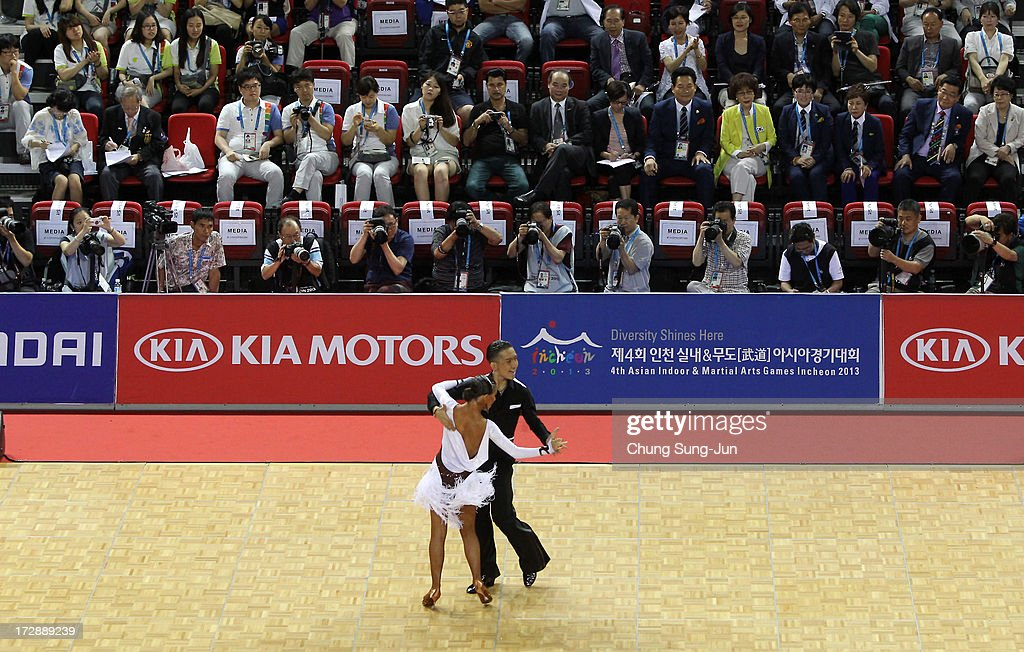Ayan Zhumatayev and partner Liya Kazbekova of Kazakhstan compete in the Dancesport- Latin Cha Cha Cha Final at Samsan World Gymnasium during day seven of the 4th Asian Indoor & Martial Arts Games on July 5, 2013 in Incheon, South Korea.