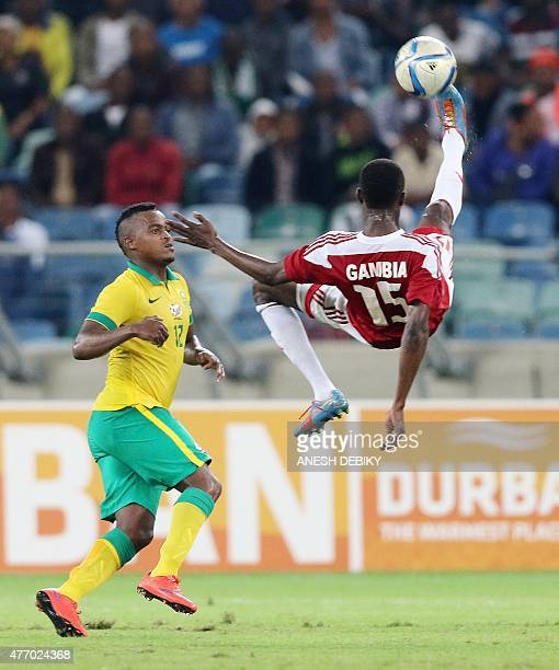 Ayanda Patosi of South Africa watches Ebrima Sohna of Gambia take a bicycle kick during their Group M 2017 Africa Cup of Nations qualifying football...