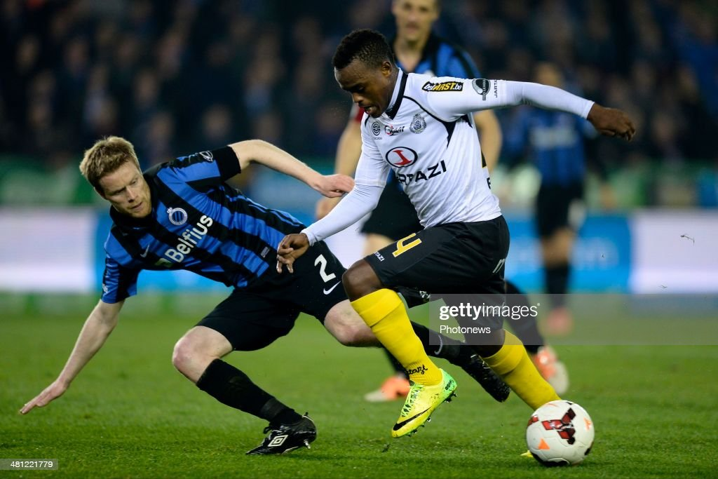 Ayanda Patosi of Sporting Lokeren OVL is challenged by Tom Hogli of Club Brugge during the Jupiler Pro League Play-Off 1 match between Club Brugge and Sporting Lokeren on March 28, 2014 in the Jan Breydel Stadium in Brugge, Belgium.