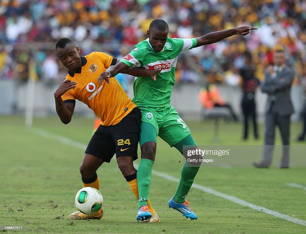 Ayanda Phelelani Dlamini of AmaZulu looks to make a tackle on Tsepo Masilela of Kaizer Chiefs during the Absa Premiership match between AmaZulu and Kaizer Chiefs at Moses Mabida Stadium on December 22, 2013 in Durban, South Africa.