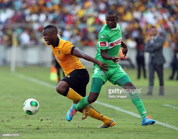 Ayanda Phelelani Dlamini of AmaZulu looks to make a tackle on Tsepo Masilela of Kaizer Chiefs during the Absa Premiership match between AmaZulu and...