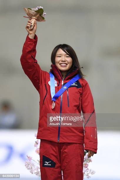 Ayano Sato of Japan poses on the podium during award ceremony for the speed skating ladies mass start on the day six of the 2017 Sapporo Asian Winter...