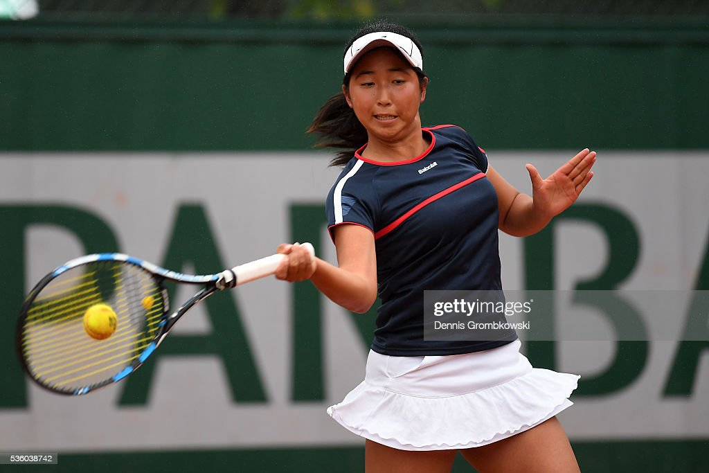 Ayano Shimizu of Japan hits a forehand during the Girls Singles first round match against Tessah Andrianjafitrimo of France on day ten of the 2016 French Open at Roland Garros on May 31, 2016 in Paris, France.