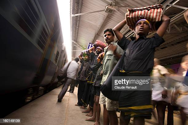 CONTENT] Ayappa pilgrims waiting for their train in Tirupati train station You can come across those pilgrims in Southern India from November to...