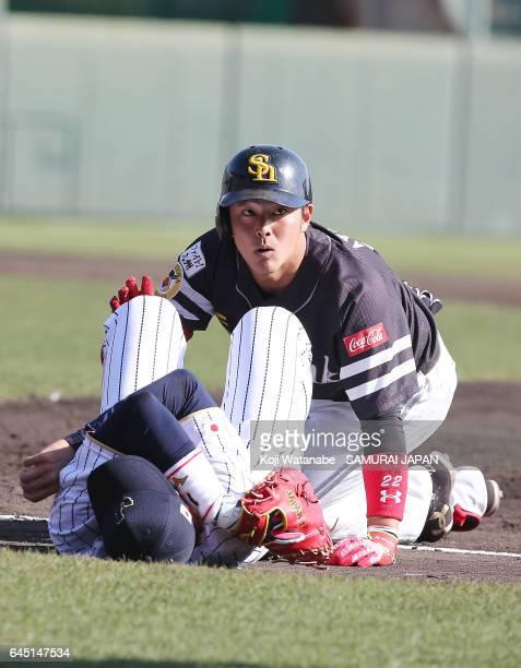 Ayatsugu Yamashita of Fukuoka SoftBank Hawks looks up after crashing with Seiichi Uchikawa of Samurai Japan in the eighth inning during the SAMURAI...