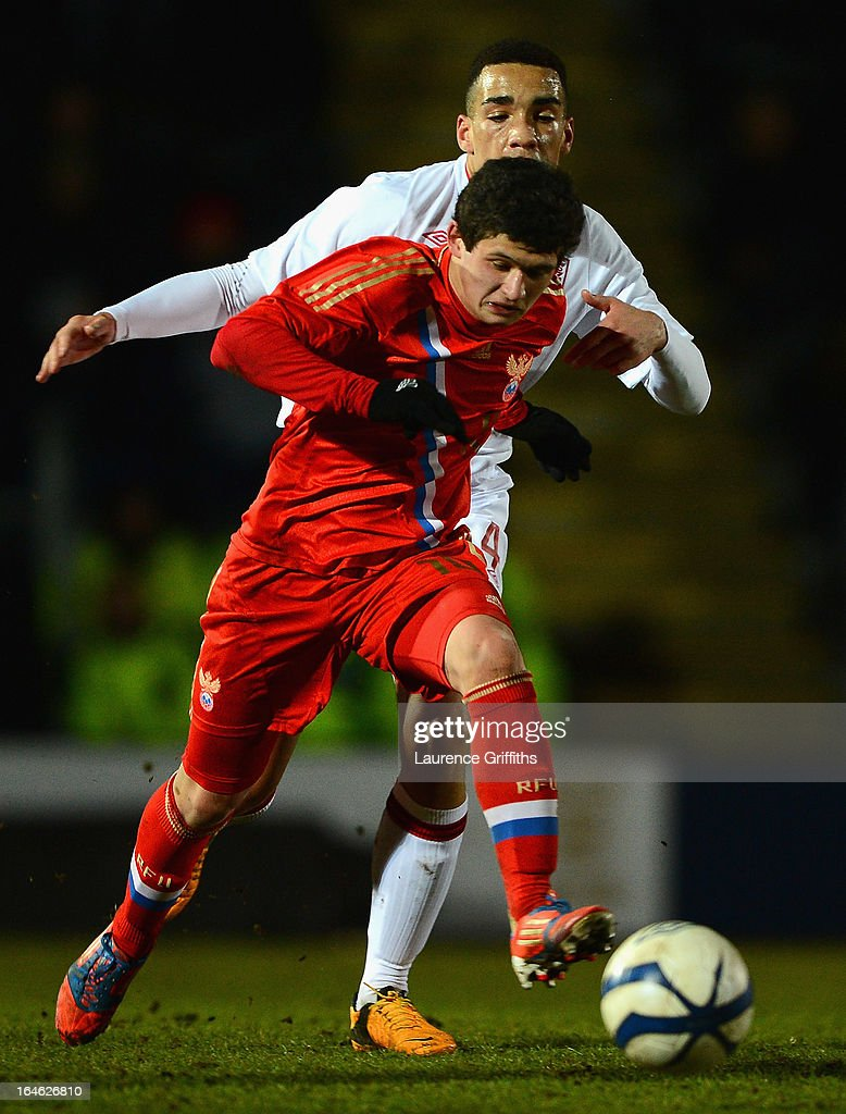 Ayaz Guliev of Russia battles with Kean Bryan of England during the UEFA European Under-17 Championship Elite Round match between England Under-17 and Russia U-17at Pirelli Stadium on March 25, 2013 in Burton-upon-Trent, England.