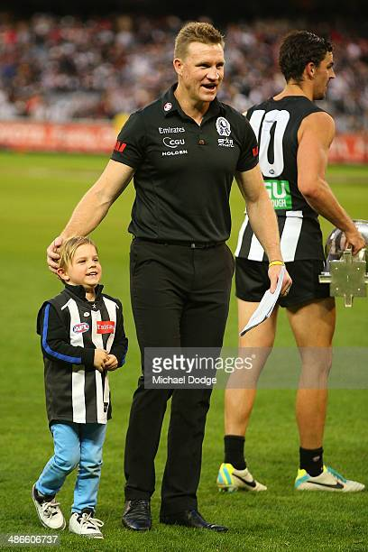 Ayce Buckley celebrates the win with his dad and coach Nathan Buckley of the Magpies during the round six AFL match between the Collingwood Magpies...