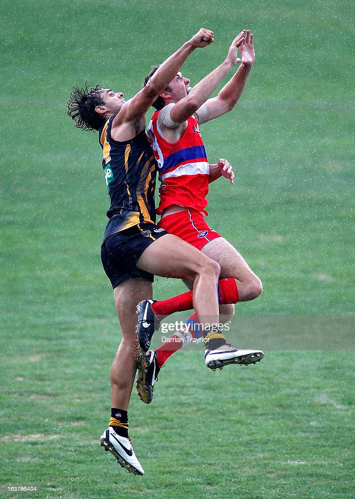 Ayce Cordy of the Bulldogs and Ben Griffiths of the Tigers leap at the ball during the AFL practice match between the Richmond Tigers and the Western Bulldogs at Visy Park on March 16, 2013 in Melbourne, Australia.