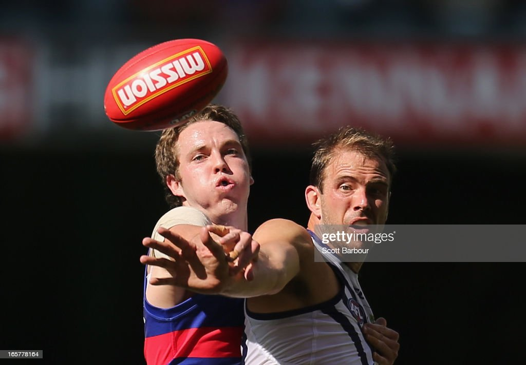 Ayce Cordy of the Bulldogs and Kepler Bradley of the Dockers compete for the ball during the round two AFL match between the Western Bulldogs and the Fremantle Dockers at Etihad Stadium on April 6, 2013 in Melbourne, Australia.
