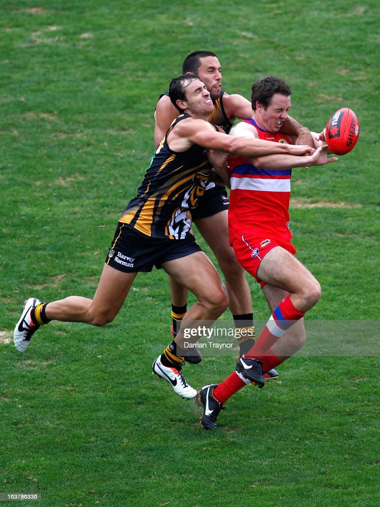 Ayce Cordy of the Bulldogs attempts to mark the ball during the AFL practice match between the Richmond Tigers and the Western Bulldogs at Visy Park on March 16, 2013 in Melbourne, Australia.