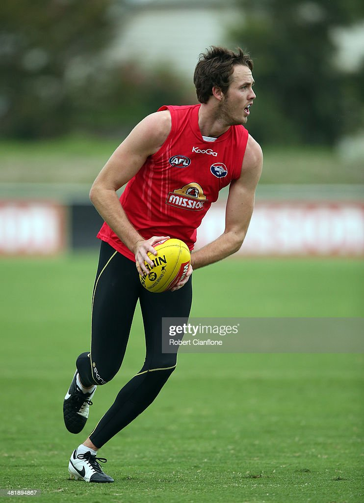 Ayce Cordy of the Bulldogs runs with the ball during a Western Bulldogs AFL training session at Whitten Oval on April 2, 2014 in Melbourne, Australia.