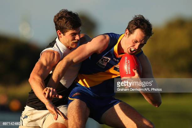 Ayce Cordy of Williamstown is tackled during the round nine VFL match between Williamstown and North Ballarat at Burbank Oval on June 18 2017 in...