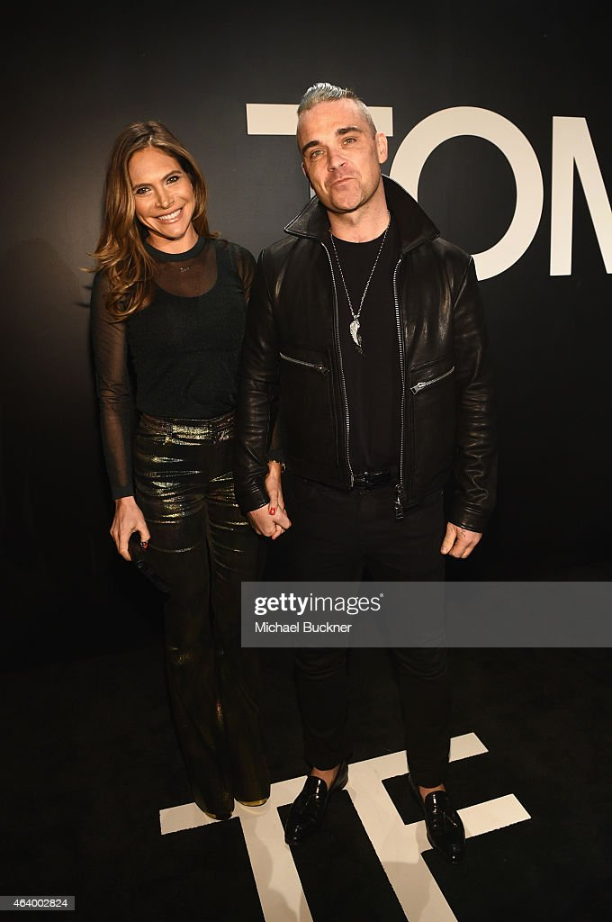 Ayda Field and Robbie Williams attend the TOM FORD Autumn/Winter 2015 Womenswear Collection Presentation at Milk Studios in Los Angeles on February...
