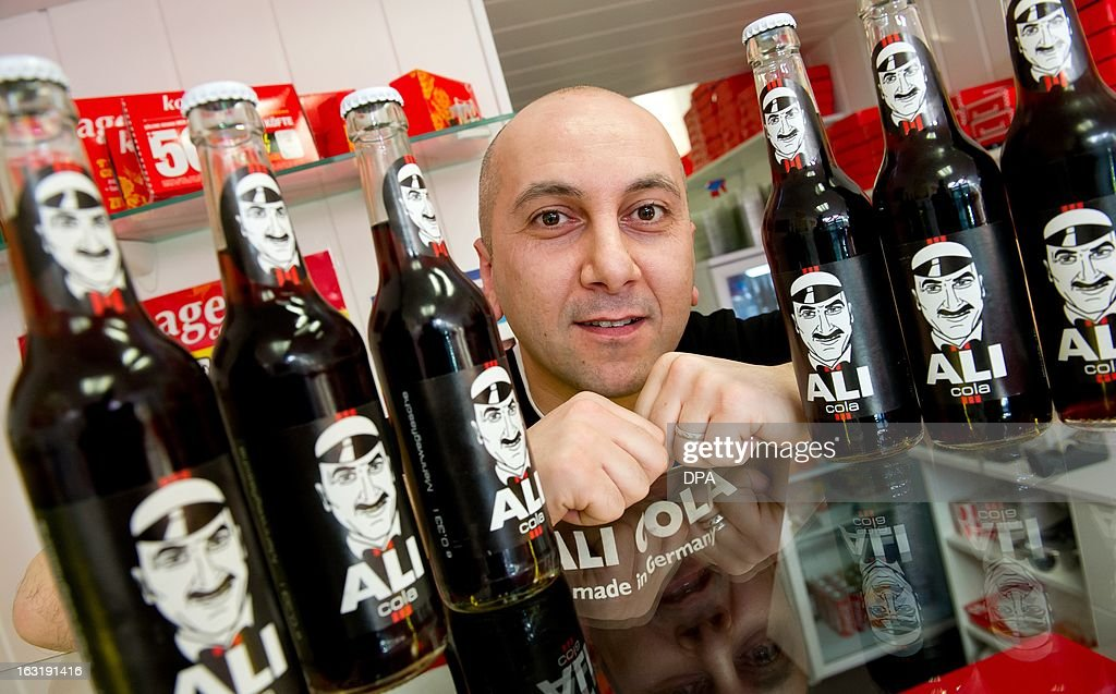 Aydin Umutlu, inventor of 'Ali Cola', poses with a bottle of Ali-Cola in a restaurant in Hamburg, Germany, on March 5, 2013. Aydin Umutlu wants to make a comment on the integration debate with his cola.