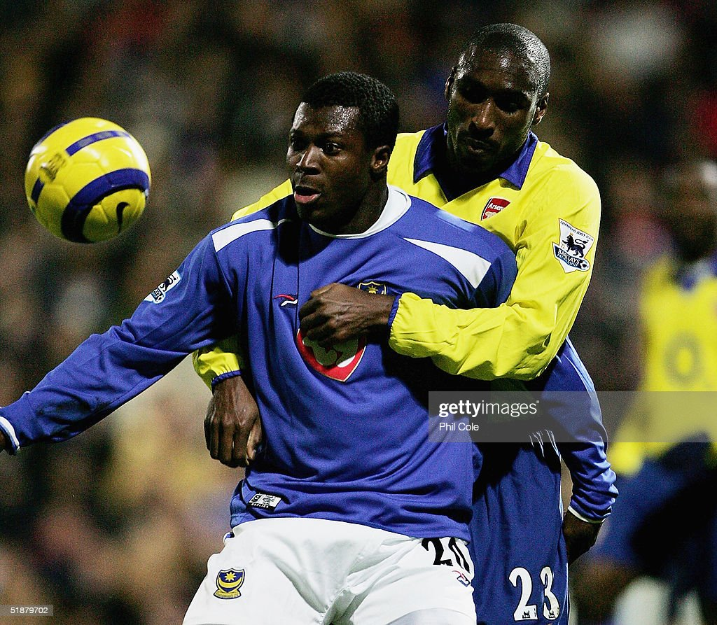 Ayegbeni Yakubu of Portsmouth holds off Sol Campbell of Arsenal during the Barclays Premiership match between Portsmouth and Arsenal at Fratton Park on December 19, 2004 in London, England.