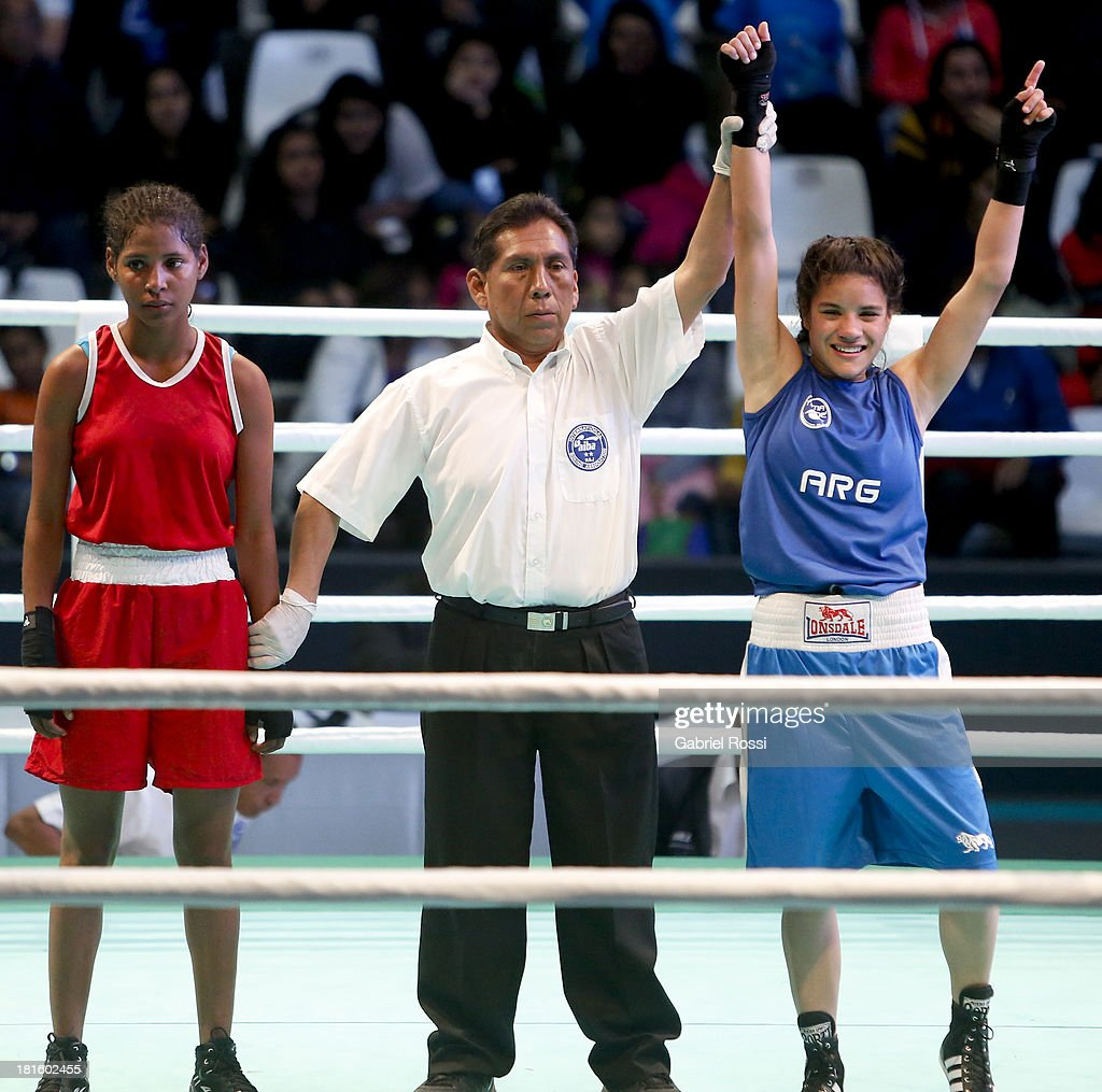 Ayelen Espinosa (blue) of Argentina celebrates after defeating Naneth Carrion (red) of Panama during the Women's 48kg Boxing Qualifications as part of the I ODESUR South American Youth Games at Coliseo Miguel Grau on September 22, 2013 in Lima, Peru.