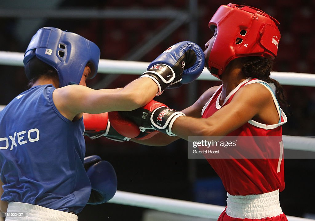 Ayelen Espinosa (blue) of Argentina competes with Naneth Carrion (red) of Panama during the Women's 48kg Boxing Qualifications as part of the I ODESUR South American Youth Games at Coliseo Miguel Grau on September 22, 2013 in Lima, Peru.