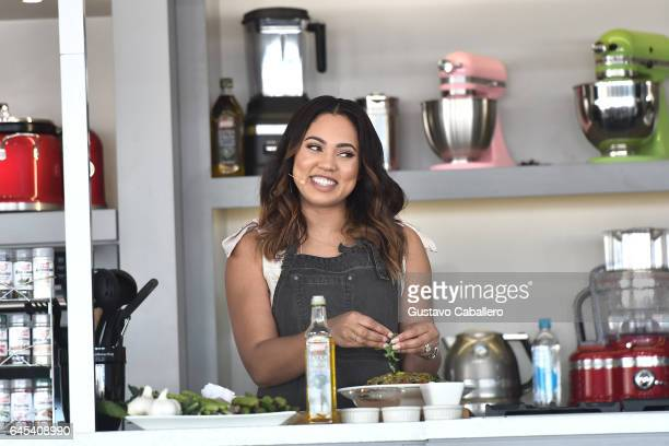 Ayesha Curry gives a cooking demo on stage at Goya Foods' Grand Tasting Village Featuring Mastercard Grand Tasting Tents KitchenAid Culinary...
