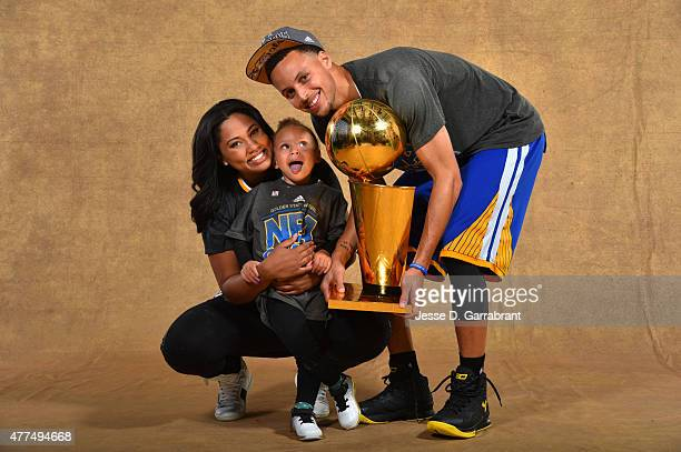 Ayesha Curry Riley Curry and Stephen Curry of the Golden State Warriors poses for a portrait with the Larry O'Brien trophy after defeating the...