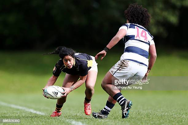 Ayesha LetiLiga of Wellington looks to make a run at Teuila FotuMoala of Auckland during the round one Farah Palmer Cup match between Auckland and...