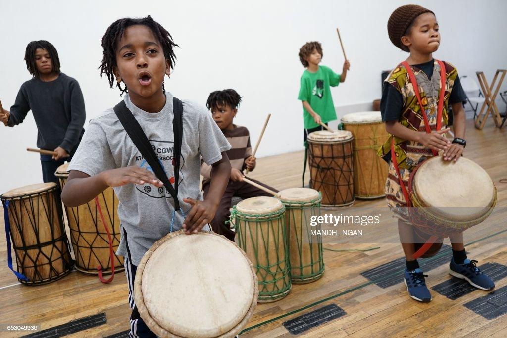 Ayinde, 10, who is home-schooled by his mother Monica Utsey, takes part in an African drumming class as an extracurricular activity in Mount Rainier, Maryland on February 24, 2017. / AFP PHOTO / MANDEL NGAN / With AFP Story by Margaret