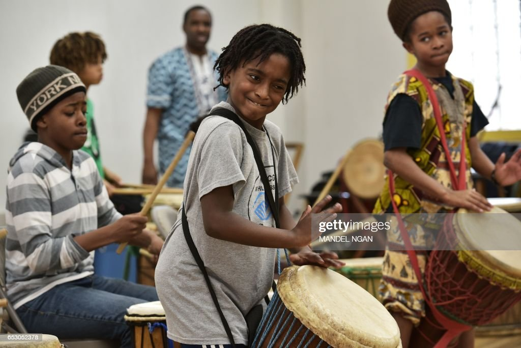 Ayinde, 10, who is homeschooled by his mother Monica Utsey, takes part in an African drumming class as an extracurricular activity in Mount Rainier, Maryland on February 24, 2017. / AFP PHOTO / MANDEL NGAN / With AFP Story by Margaret