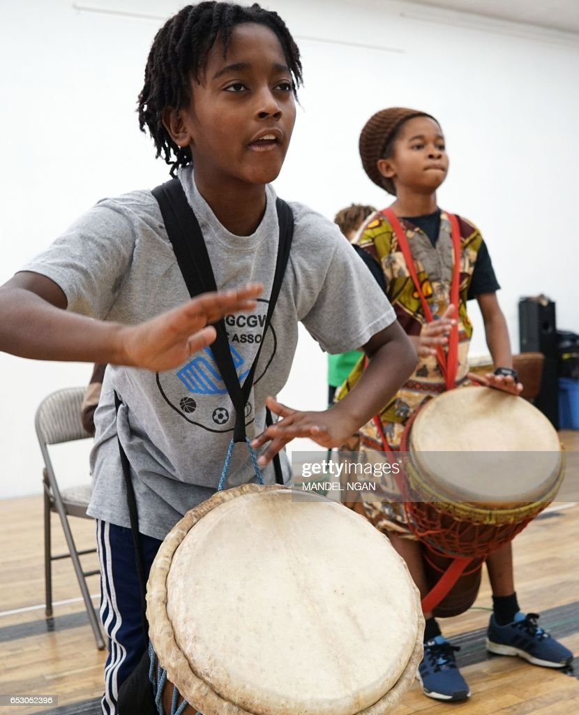 Ayinde, 10, who is homeschooled by his mother Monica Utsey, takes part in an African drumming class as an extracurricular activity in Mount Rainier, Maryland on February 24, 2017