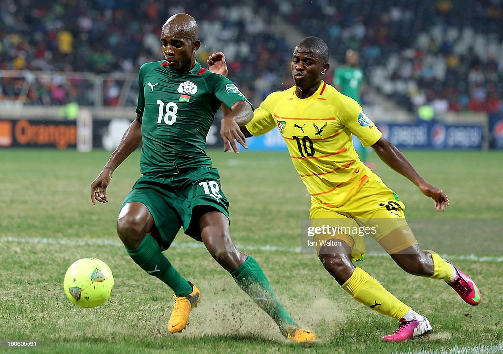 Ayite Floyd Ama of Togo tries to tackle Kabore Charles of Burkina Faso during the 2013 Africa Cup of Nations Quarter-Final match between Burkina Faso and Togo at the Mbombela Stadium on February 3, 2013 in Nelspruit, South Africa.