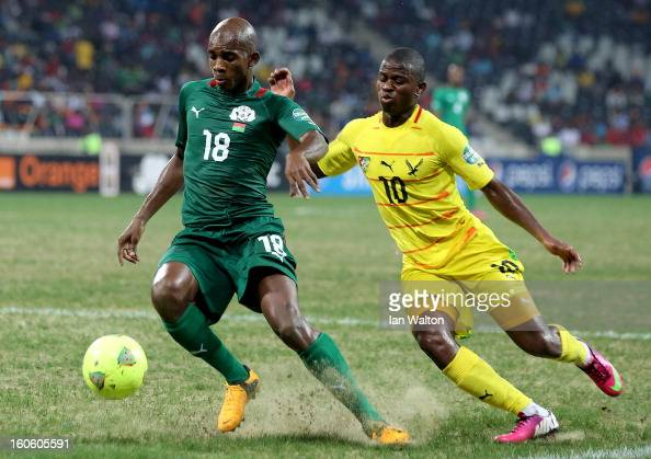 Ayite Floyd Ama of Togo tries to tackle Kabore Charles of Burkina Faso during the 2013 Africa Cup of Nations QuarterFinal match between Burkina Faso...