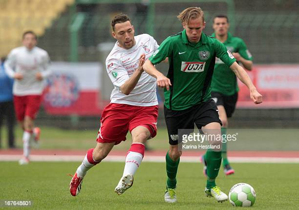 Aykut Oeztuerk of Erfurt challenges Dennis Grote of Muenster during the 3rd Liga match between RW Erfurt and Preussen Muenster at Steigerwald Stadion...