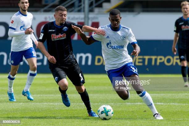 Aykut Soyak of Paderborn and Haji Wright of Schalke battle for the ball during the preseason friendly match between SC Paderborn and FC Schalke 04 at...