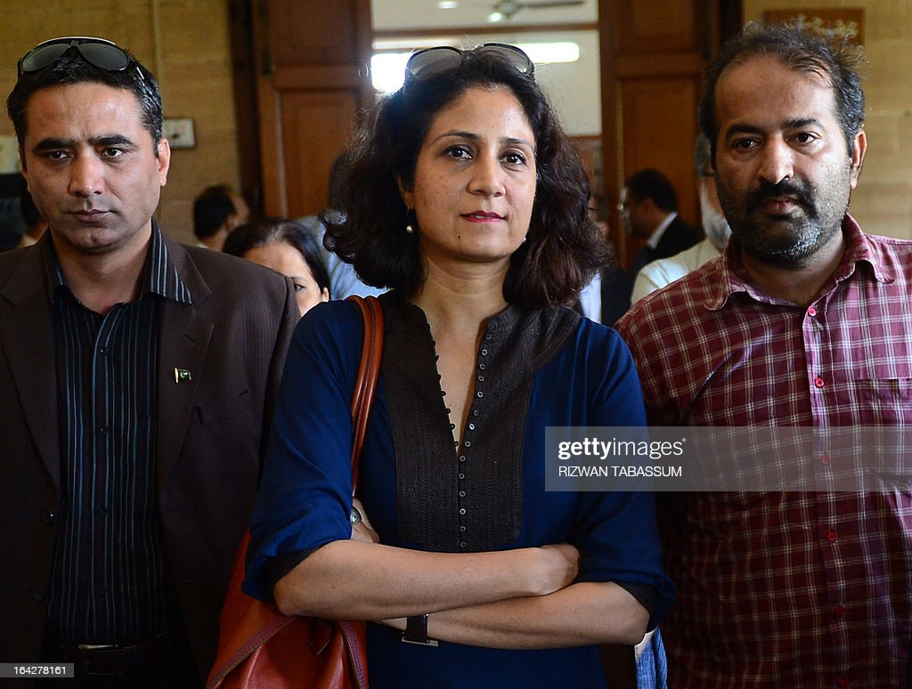 Ayla Raza, daughter of Pakistan's former military ruler Pervez Musharraf, stands outside a courtroom with her father's supporters in the southern Sindh provincial high court in Karachi on March 22, 2013. Pakistan's former military ruler Pervez Musharraf was Friday granted protective bail in a series of legal cases, paving the way for his return from exile without the risk of immediate arrest. AFP PHOTO/ Rizwan TABASSUM