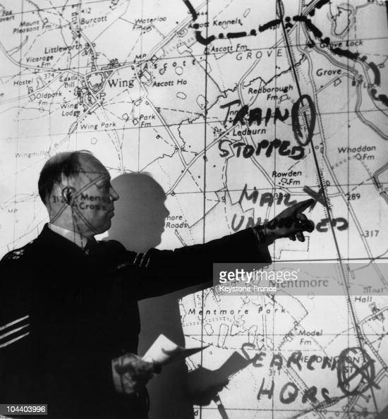 Aylesbury police station UK during Scotland Yard's investigation A British policeman pointing his finger on the region's map where a spectacular...