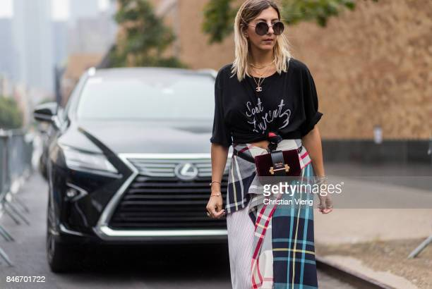 Aylin Koenig in front of a Lexus seen in the streets of Manhattan outside Marchesa during New York Fashion Week on September 13 2017 in New York City