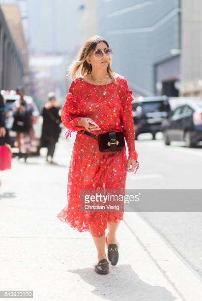 Aylin Koenig seen wearing a red Preen dress Prada belt bag in the streets of Manhattan outside Desigual during New York Fashion Week on September 7...