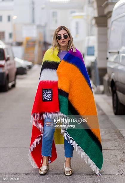 Aylin Koenig wearing a Loewe blanket ripped denim jeans Gucci shoes during the MercedesBenz Fashion Week Berlin A/W 2017 at Kaufhaus Jandorf on...