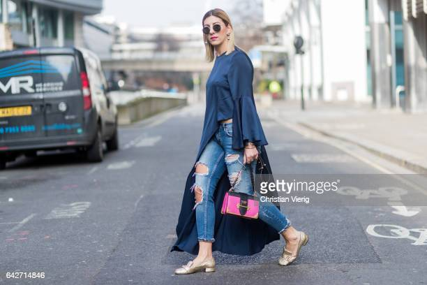 Aylin Koenig wearing a Prada bag Gucci slippers ripped denim jeans white navy top outside Julien Macdonald on day 2 of the London Fashion Week...