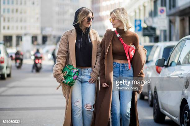 Aylin Koenig wearing green Gucci bag and Lisa Hahnbueck wearing a brown Max Mara coat Max Mara turtleneck Levis wedgie jeans Gianvito Rossi heels...