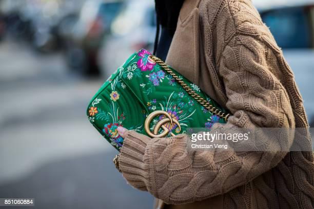Aylin Koenig wearing green Gucci bag is seen outside Max Mara during Milan Fashion Week Spring/Summer 2018 on September 21 2017 in Milan Italy