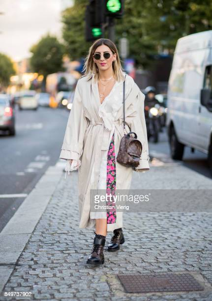 Aylin Koenig wearing white trench Louis Vuitton backpack outside Tommy Hilfiger during London Fashion Week September 2017 on September 19 2017 in...