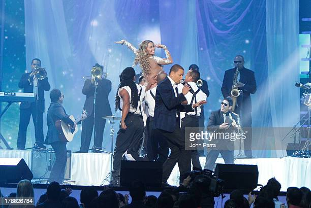 Aylin Mujica and Victor Manuelle on stage during Telemundo's Premios Tu Mundo Awards at American Airlines Arena on August 15 2013 in Miami Florida