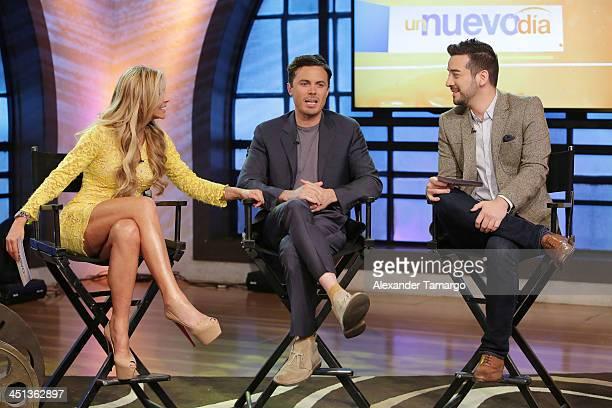Aylin Mujica Casey Affleck and Francisco Caceres appear on the set of Telemundo's morning show 'Un Nuevo Dia' at Telemundo Studio on November 22 2013...