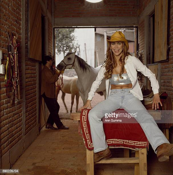Aylin Mujica in her stable with husband for story Bodies After Babies People En Espanol