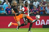 Ayman Abdennour of Valencia CF Eljero Elia of Feyenoord during the preseason friendly match between Feyenoord and Valencia on July 23 2016 at the...