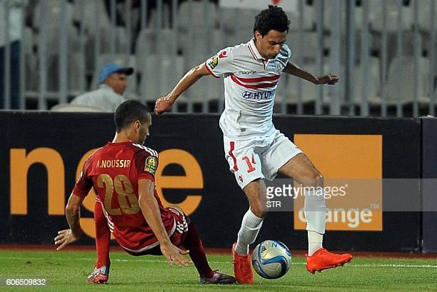 Ayman Hefny of Egypts Zamalek club fights for the ball with Abdellatif Noussir of Moroccos Wydad Athletic Club during their CAF Champions League...